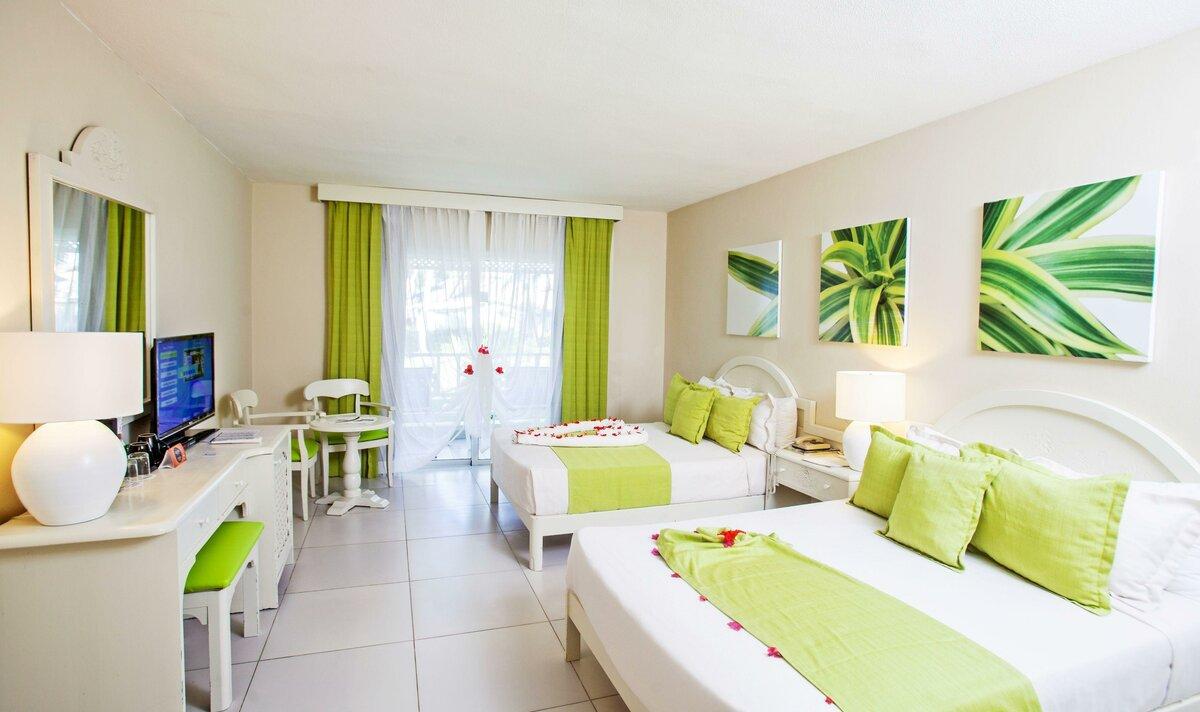Фото номера в отеле Vista Sol Punta Cana Beach Resort